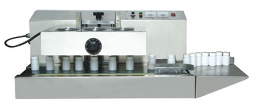 Automatic side sealer and shrink tunnel